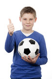Young boy holding a football ball Stock Photo