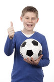 Young boy holding a football ball Royalty Free Stock Images