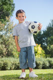 Young boy holding football Royalty Free Stock Image