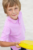 Young boy holding frisbee Royalty Free Stock Image