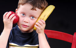 Young boy holding fruit Royalty Free Stock Photography