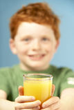 Young Boy Holding Glass Of Juice Stock Photos