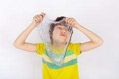Young boy holding a glitter slime in front of him stock image