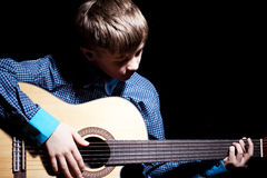 Young Boy Holding Guitar Royalty Free Stock Images