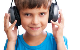 The young boy is holding the headphones Stock Images