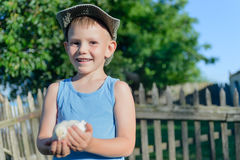 Young Boy Holding His Chick While at the Garden Royalty Free Stock Image