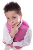 Young boy holding his chin in his First Holy Communion looking f Royalty Free Stock Images