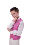 Young boy holding his chin in his First Holy Communion on white Royalty Free Stock Photos