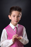 Young boy holding his medals in his First Holy Communion Royalty Free Stock Images