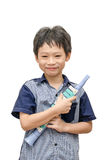 Young boy holding his  trumpet toy Stock Photos