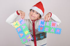 Young boy holding a last year and new year sign Royalty Free Stock Image