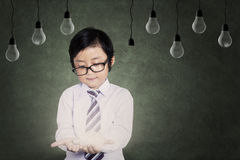 Young boy holding a light bulb Stock Photography