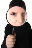 Young boy holding magnifying glass Stock Images