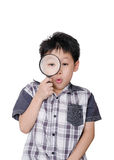 Young boy holding magnifying glass Royalty Free Stock Images