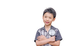 Young boy holding magnifying glass Stock Photo
