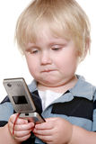 Young boy holding mobile phone Royalty Free Stock Image