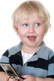 Young boy holding mobile phone Royalty Free Stock Photos