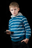 Young Boy holding mobile phone Royalty Free Stock Photo