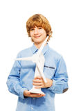 Young boy holding model of wind generator turbine Stock Image