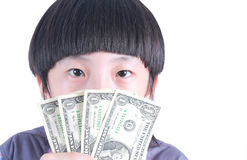 Young boy holding money Royalty Free Stock Photos