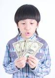 Young boy holding money Stock Image