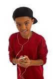 Young boy holding MP3 player Royalty Free Stock Photos