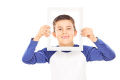 Young boy holding a picture frame Stock Images