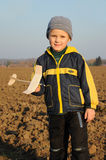 Young boy holding plane model Royalty Free Stock Photos