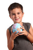 A young boy is holding the planet Earth Royalty Free Stock Photography