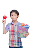 Young boy holding plastic ball over white Stock Photos