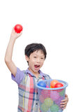Young boy holding plastic ball over white Royalty Free Stock Photography