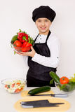 Young boy holding a plate with vegetables isolate Stock Image