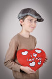 Young boy holding a plush red heart Royalty Free Stock Images