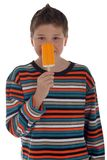 Young boy holding popsicle Royalty Free Stock Images