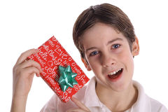 Young boy holding present Royalty Free Stock Images