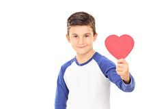 Young boy holding a red heart royalty free stock photography