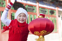 Young boy holding red lantern Stock Images