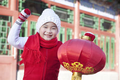 Young boy holding red lantern Stock Photos