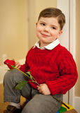 Young boy holding red rose Royalty Free Stock Photos