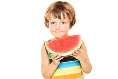 Young boy holding a slice of watermelon Stock Image