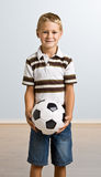 Young boy holding soccer ball Royalty Free Stock Photos