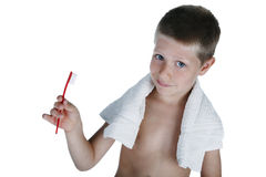 Young boy holding toothbrush, studio shot royalty free stock photography