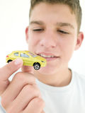 Young boy holding toy car and smiling Royalty Free Stock Photography