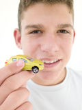 Young boy holding toy car and smiling Royalty Free Stock Images
