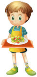 A young boy holding a tray with a plate Stock Photography