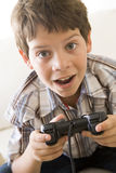 Young boy holding video game controller.  Stock Photography