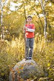 Boy Standing on a Rock Stock Photos