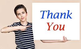 Young boy holding white board with thank you message stock photography