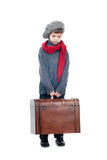 A young boy holding wooden trunk. A portrait of a sad young boy holding wooden trunk and looking down,  on white background Royalty Free Stock Images