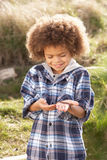 Young Boy Holding Worm Outdoors Royalty Free Stock Photo
